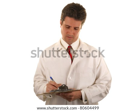 A young doctor new to his health care job fills out a prescription for a sick patient. - stock photo