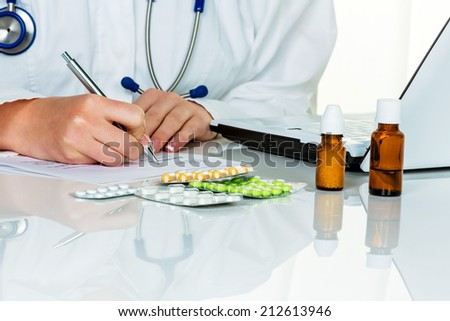 a young doctor prescribes medication. prescription pills are prescribed by the doctor. - stock photo