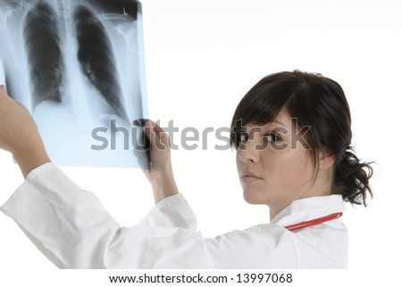 a young doctor with a x-ray image get a diagnosis - stock photo