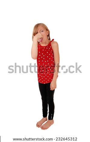 A young eight year old girl standing for white background, holding her nose for the bad smell and with her tongue out.  - stock photo