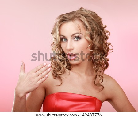 A young emotional woman, isolated on pink background - stock photo