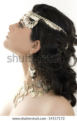 A young ethnic belly dancer isolated on a white background. - stock photo