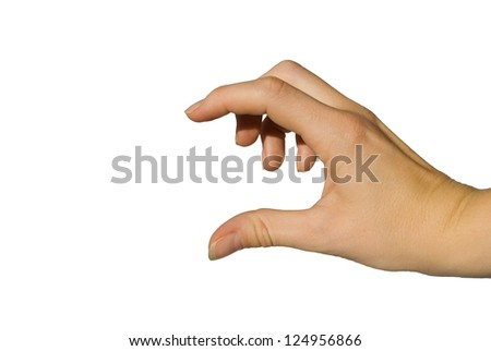 a young european looking hand shows something little or big between its fingers - stock photo