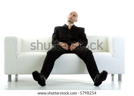 A young executive looks up, losing patience while he waits. - stock photo
