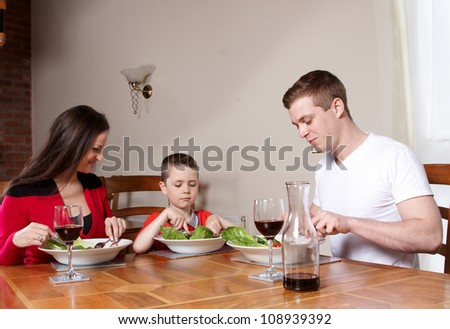 A young family having a light lunch together