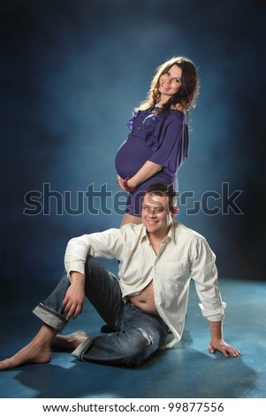 a young family in anticipation of the firstborn - stock photo