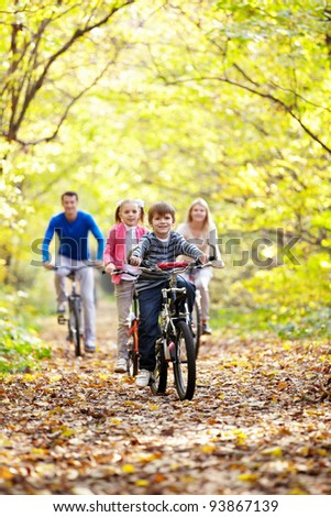 A young family with children on bicycles