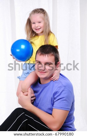 A young father and daughter together in sports