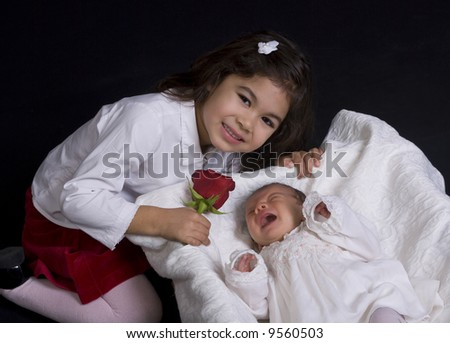 A young father and his two small children. Family, love, caring. - stock photo
