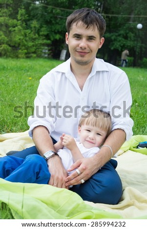 a young father and young son on the nature happy family - stock photo