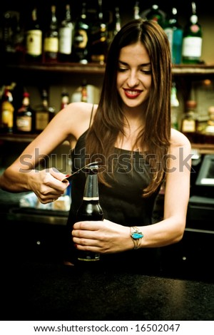 A young female bartender, photographed at work.