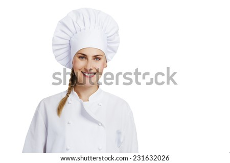 A young, female chef in a traditional hat and coat.  - stock photo