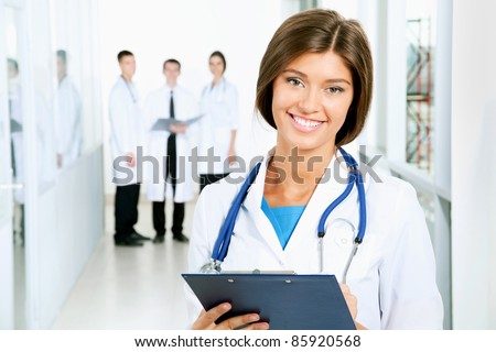 A young female doctor looking at camera - stock photo