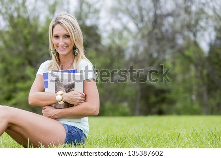 A young female enjoys a day at the park - stock photo