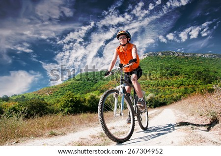A young female riding a mountain bike outdoor - stock photo