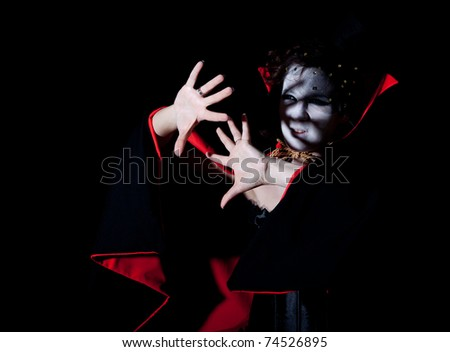 a young female vampire protecting herself from bright light