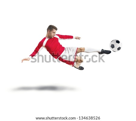 A young footballer play on white background - stock photo