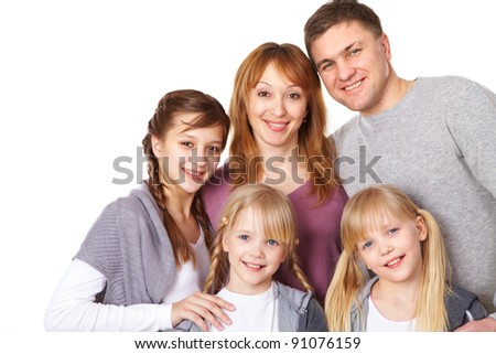 A young friendly family looking at camera - stock photo
