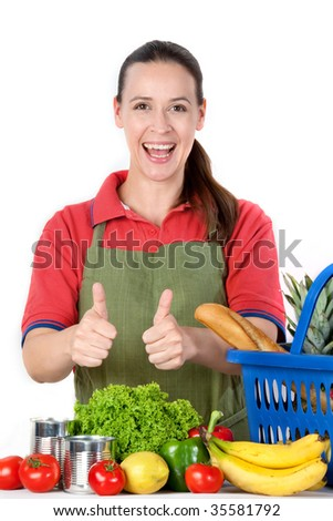 A young friendly grocery store assistant with thumbs up