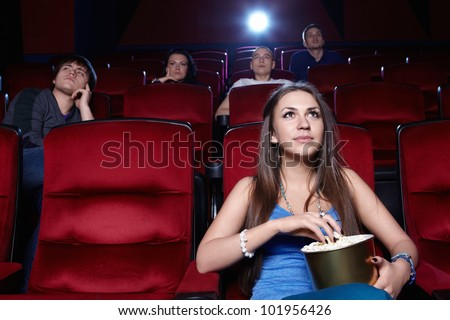 A young girl at the cinema - stock photo