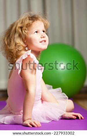 A young girl ballet dancer in a pink lace tutu. - stock photo