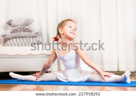 A young girl ballet dancer in a white lace tutu. - stock photo