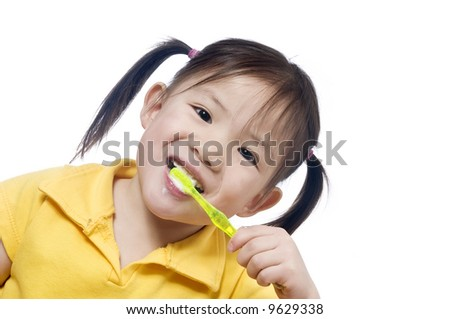 A young girl brushing herteeth. Health and living. - stock photo