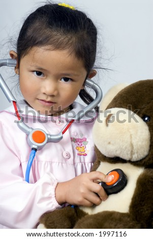 A young girl cares for her sick bear - stock photo