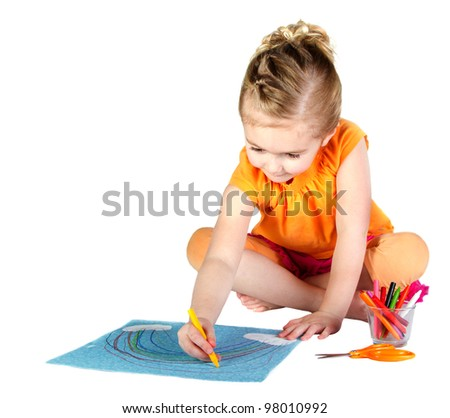 A young girl coloring a rainbow isolated on a white background