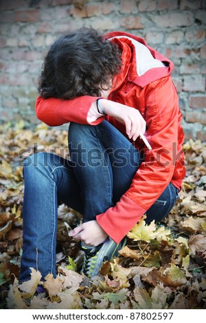 A Young Girl depression and doing drugs - stock photo