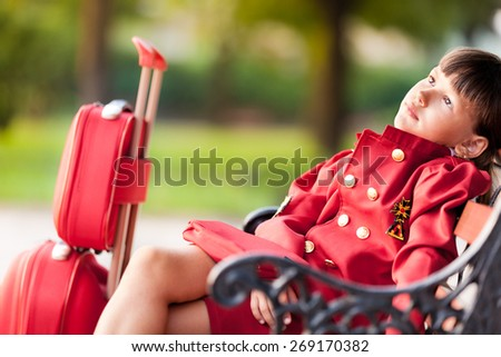 A young girl dressed as a flight attendant sees the sights - stock photo