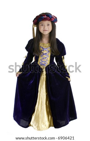 A young girl dressed up in royal gown. Childhood, youth, growing up. - stock photo