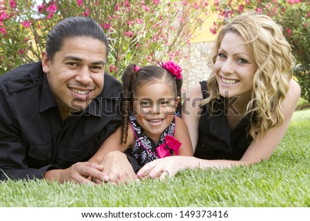 A young girl enjoys the afternoon with her family. - stock photo