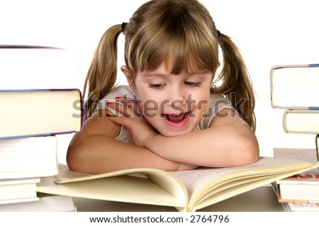 A young girl happy about reading a book - stock photo