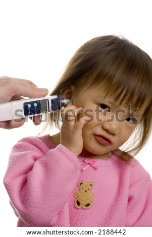 A young girl has her temperature taken - stock photo