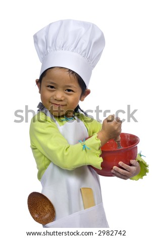 A young girl having fun in the kitchen making a mess....I mean making cookies. Education, learning, cooking, childhood - stock photo