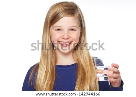 a young girl holding a glass of water - stock photo