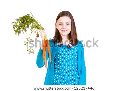 a young girl holding carrots