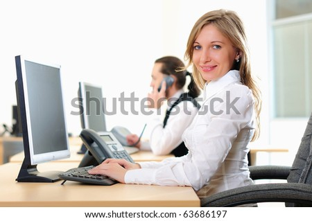A young girl in his office at his workplace works at the computer - stock photo