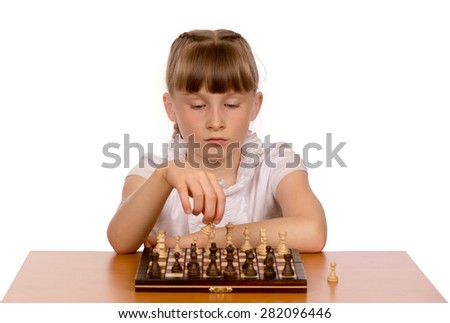 A young girl is playing chess.