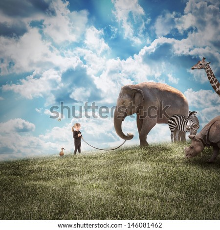 A young girl is walking a big elephant on a wild landscape with other animals following on a path to protection or freedom. - stock photo