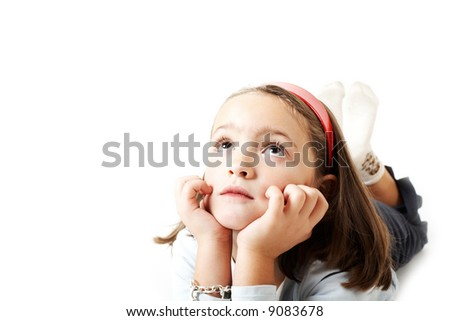 A young girl laying and thinking serious