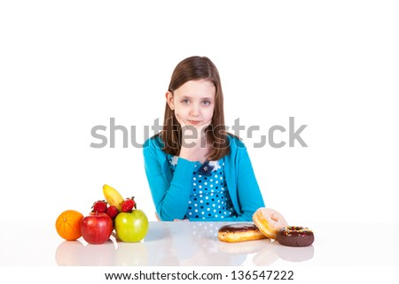 a young girl making a healthy versus junk food decision