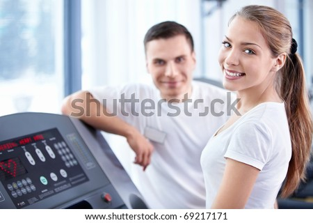 A young girl on a treadmill - stock photo