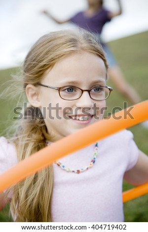 A young girl playing - stock photo