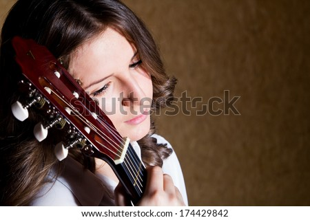 A young girl playing guitar