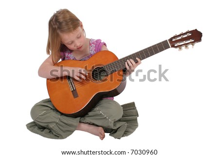 A young girl playing guitar.