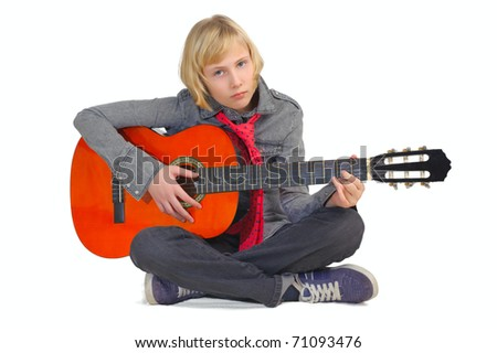 A young girl playing guitar. - stock photo
