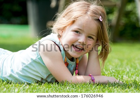 A young girl propping her head up with her hand. - stock photo