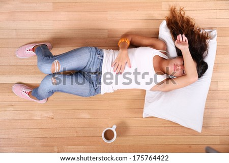 A young Girl relaxing with some Coffee at home. - stock photo
